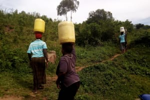 The Water Project: Banja Primary School -  People Carrying Water Home
