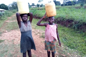 The Water Project: Womulalu Special School -  Carrying Water