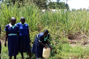 The Water Project: Mukama Primary School -  Fetching Water At Open Well