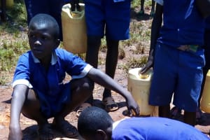 The Water Project: Demesi Primary School -  Fetching Water