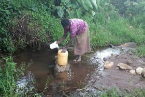 The Water Project: Kambiri Community, Sachita Spring -  Fetching Water