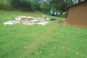 The Water Project: Ikonyero Community, Amkongo Spring -  Clothes Drying On The Ground