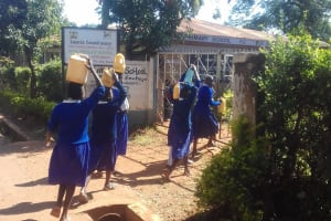 The Water Project: Kima Primary School -  Arriving At School With Water