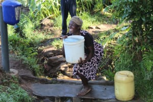The Water Project: Bukhakunga Community, Mukomari Spring -  Fetching Water