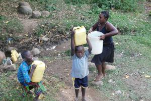 The Water Project: Eshiasuli Community, Eshiasuli Spring -  Carrying Water