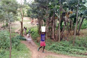 The Water Project: Buhayi Community, Nasichundukha Spring -  Carrying Water