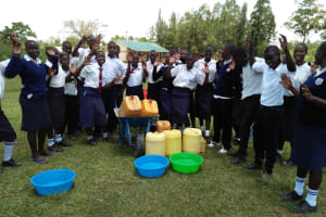 The Water Project: Bululwe Secondary School -  Carrying Water To School