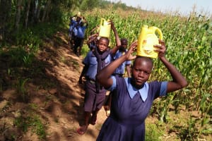 The Water Project: Enyapora Primary School -  Carrying Water