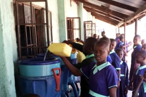 The Water Project: Mukama Primary School -  Filling The Plastic Filters