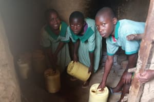 The Water Project: Bugute Lutheran Primary School -  Dropping Water Off At School Kitchen