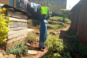 The Water Project: Lutonyi Community, Lutomia Spring -  Latifa Balancing A Water Bucket On Her Head
