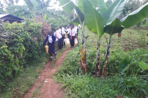 The Water Project: Ikumba Secondary School -  Carrying Water To School
