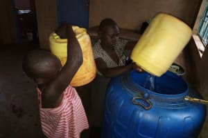 The Water Project: Womulalu Special School -  Storing Spring Water