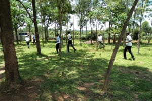 The Water Project: Bululwe Secondary School -  Boys Rushing To Latrines