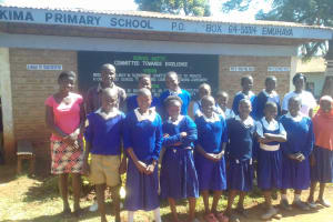 The Water Project: Kima Primary School -  Students Posing With Teachers