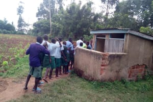 The Water Project: Bumbo Primary School -  Boys Lined Up At Their Latrines