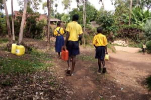 The Water Project: Friends Primary School Givogi -  Carrying Water Back