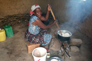 The Water Project: Bugute Lutheran Primary School -  School Cook Making Lunch