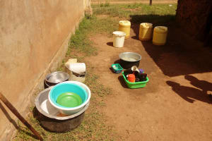 The Water Project: Ebukhayi Primary School -  Dishes Drying On The Ground