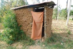 The Water Project: Eshiasuli Community, Eshiasuli Spring -  Mud Latrine