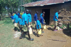 The Water Project: Shichinji Primary School -  Delivering Some Water To School Kitchen
