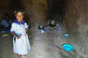 The Water Project: Enyapora Primary School -  Little Girl In The School Kitchen