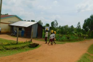 The Water Project: Mulwanda Mixed Primary School -  Carrying Water From Home To School