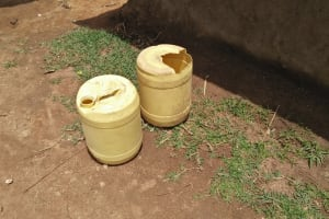 The Water Project: Tumaini Community, Ndombi Spring -  Water Containers