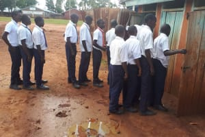 The Water Project: Ikumba Secondary School -  Boys Lined Up At Latrines