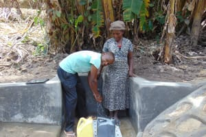 The Water Project: Bukhakunga Community, Ngovilo Spring -  Water Flowing