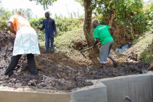 The Water Project: Mukoko Community, Mukoko Spring -  Backfilling