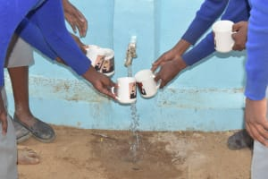 The Water Project: Kitandi Primary School -  Water Flowing