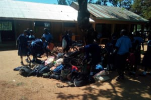 The Water Project: Enyapora Primary School -  Book Bags Under Tree