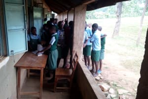 The Water Project: Bumbo Primary School -  Students Outside Classroom