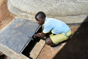 The Water Project: Mabanga Primary School -  Prefect Unlocking The Hatch