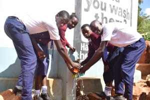 The Water Project: Ndoo Secondary School -  Water Flowing