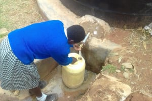 The Water Project: Dr. Gimose Secondary School -  Filling A Container To The Small Tank