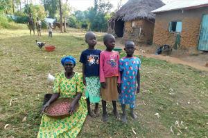 The Water Project: Eshiasuli Community, Eshiasuli Spring -  A Grandmother And Her Grandchildren