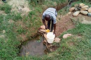 The Water Project: Shihingo Community, Inzuka Spring -  Fetching Water