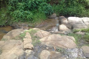 The Water Project: Dr. Gimose Secondary School -  Community River