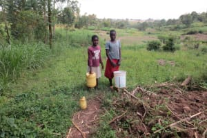 The Water Project: Ikonyero Community, Amkongo Spring -  Children With Water Containers