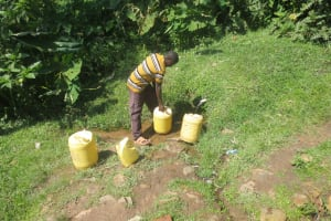 The Water Project: Bung'onye Community, Shilangu Spring -  Fetching Water