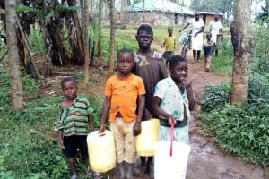 The Water Project: Buhayi Community, Nasichundukha Spring -  Waiting To Fetch Water