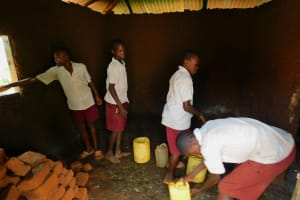 The Water Project: Mulwanda Mixed Primary School -  Delivering Water To School Kitchen