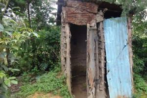 The Water Project: Eshikhugula Community, Shaban Opuka Spring -  Mud Latrine