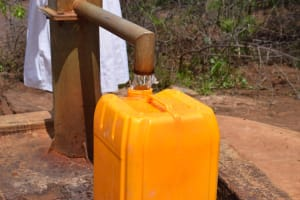 The Water Project: Maluvyu Community F -  Filling Container With Water