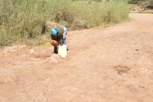 The Water Project: Mukuku Community -  Collcting Water