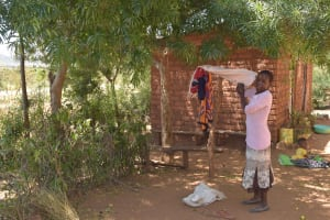The Water Project: Kaukuswi Community -  Hanging Clothes On The Line