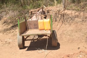 The Water Project: Kaukuswi Community -  Water Containers Ready To Be Hauled Home