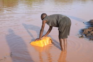 The Water Project: Kangalu Community -  Collecting Water